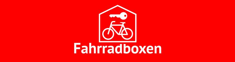"""Rotes Banner mit Text """"Fahrradboxen"""" und einem Symbolbild bestehend aus einem Schlüssel und einem Fahrrad.©Stadt Boizenburg/ Elbe"""